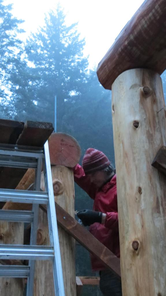 Rob monkeying around with a post-beam connection as dusk falls